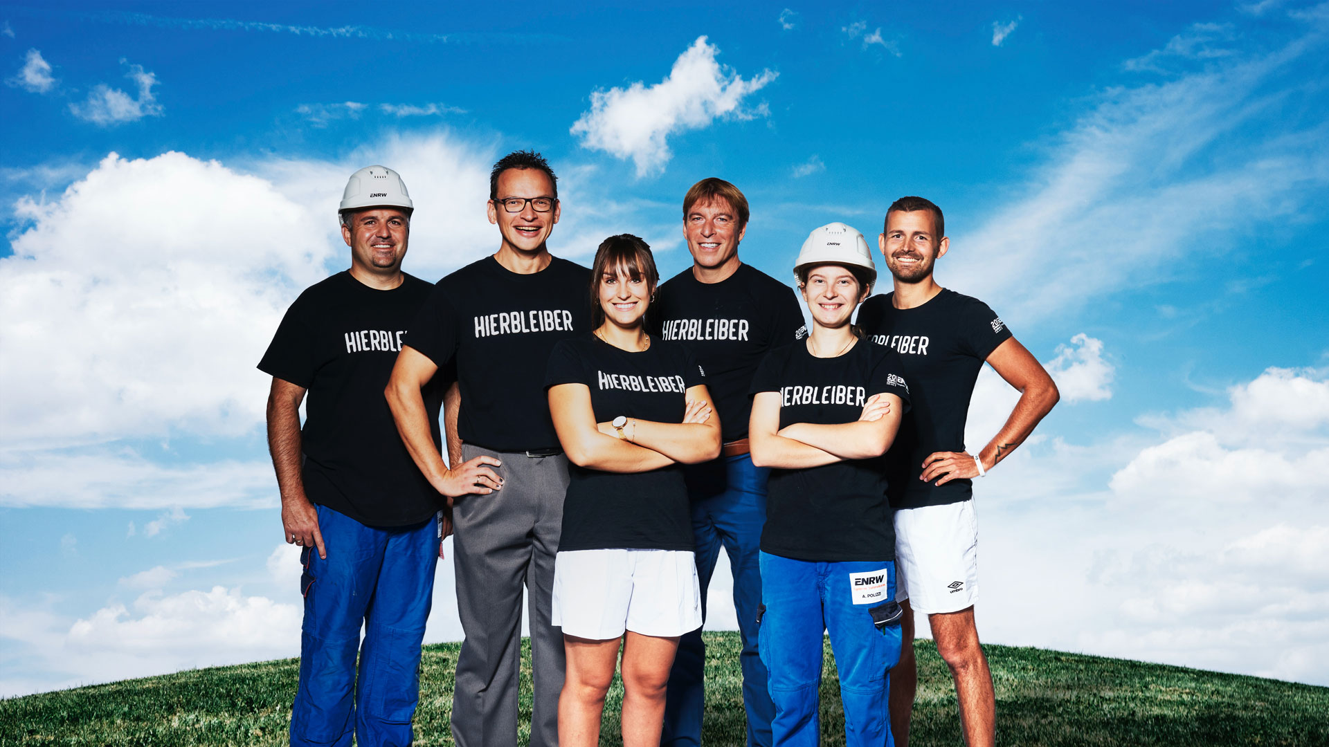 Mitarbeiter der ENRW auf grüner Wiese